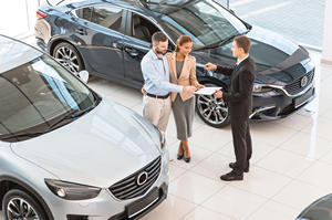 Couple buying a car